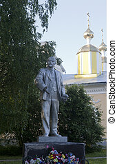 Lenin monument on the background of the domes of the church in the village of Verkhovazhye