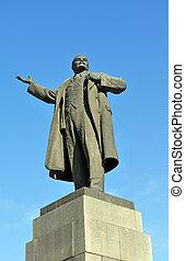 Lenin sculpture over blue sky