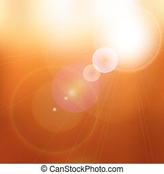 Lens flare on blurred orange and brown background