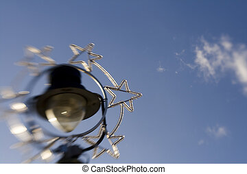 Lensbaby shot of decorated street lamp, blurring and...
