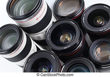(Modern hi-end professional photographic equipment - lenses, isolated on white)