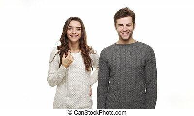 lent, naturel, couple, jeune, mouvement, arrière-plan., sourire, chandails, blanc, heureux
