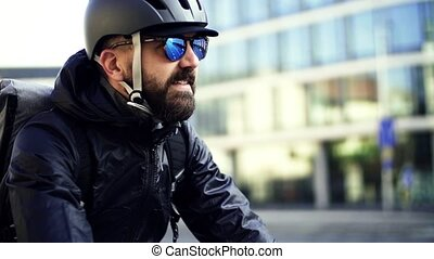 lent, va bicyclette courrier, motion., livrer, paquets, city., mâle