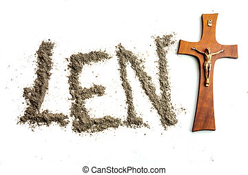 Lent word written iwith ash and christian cross as a T...