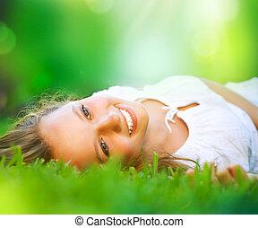 lente, meisje, het liggen, op, de, field., geluk