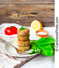 lentil cutlets with paprika and porridge, greens, tomato, ...