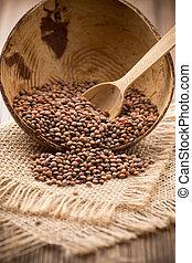 Lentil. - Lentils wooden bowl on wooden background. Healthy...