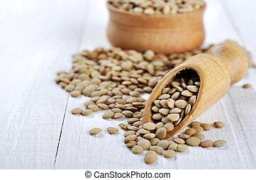 Lentil seeds on a white wooden background