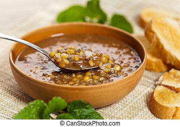 Lentil soup in bowl. Selective focus, shallow depth.
