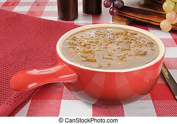 Lentil Soup - A stoneware serving dish of lentil soup