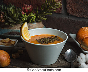 lentil soup with mint on the table