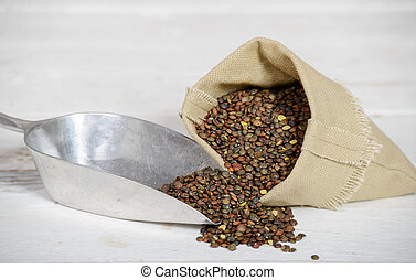 lentils in small hessian bag with kitchen shovel