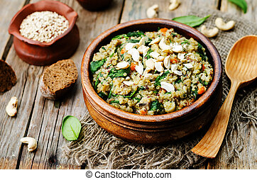 lentils mushroom spinach quinoa on a dark wood background. ...