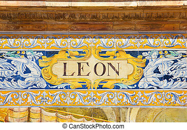 Leon sign over a mosaic wall - ceramic decoration on mosaic ...