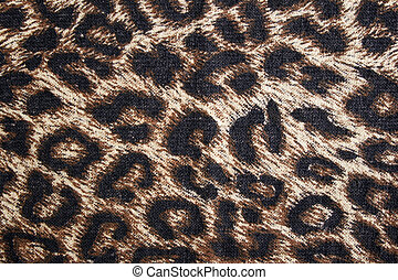 Leopard spotted fabric background. Cheetah fur pattern.