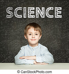 Lern Science. Clever student child on blackboard background with maths formulas