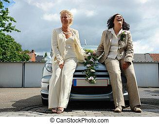 Lesbian couple - Mature lesbian couple posing after official...