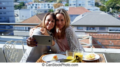 Lesbian couple taking selfie in balcony 4k - Lesbian couple...