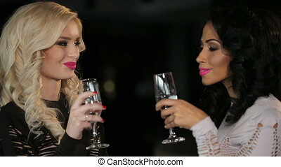 Lesbian couple with champagne