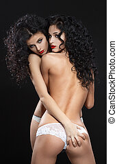 Lesbian play. Two beautiful girls in love foreplay.
