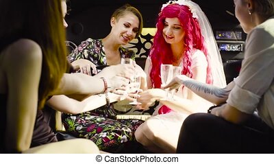 Lesbian wedding. The bride and groom riding in a wedding car...