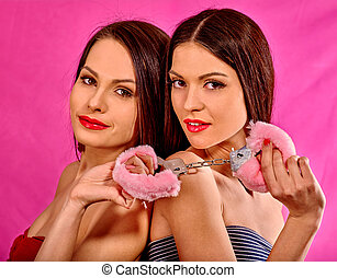 Lesbian women with handcuffs  in erotic game.