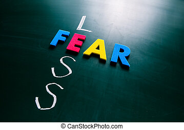 Less fear concept on blackboard - Colorful word fear and ...