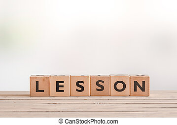 Lesson word spelled with cubes
