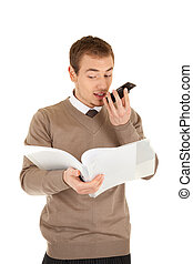 Man with is looking in papers in a file and dictating in mobile phone . Isolated on white background.