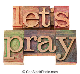 spiritual concept - let us pray phrase in vintage wood letterpress type, stained by color inks, isolated on white