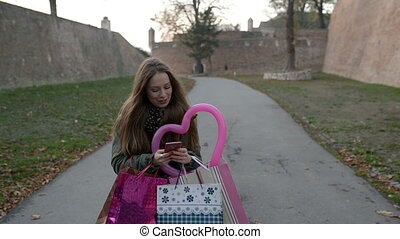 Lets buy some more - Young woman with shopping bags is happy...