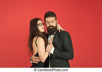 Lets dance tonight. Elegant couple in love tender hug dancing red background. Feel rhythm of heart. Happy together. Man in tuxedo and woman black dress dancing at party. Passionate couple dancing