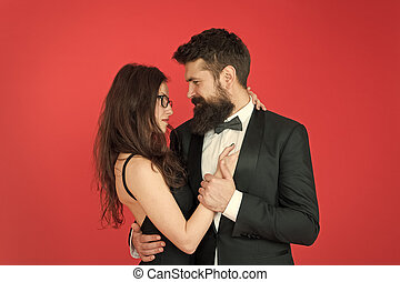 Lets dance tonight. Elegant couple in love tender hug dancing red background. Happy together. Man in tuxedo and woman black dress dancing at party. Passionate couple dancing. Feel rhythm of heart