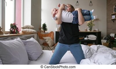 Lets fly Cheerful beautiful young woman holding baby girl in...