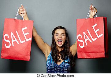 Let?s go for sale! - Portrait of joyful brunette with sale...