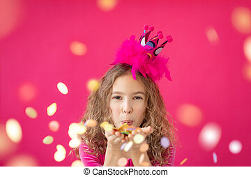 Fancy girl blowing confetti against pink bakground