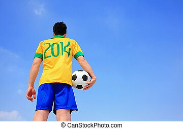 Lets play soccer now - Brazilian football player with 2014...