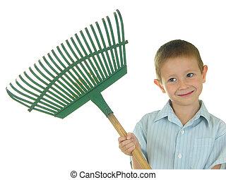 Boy holding a rake