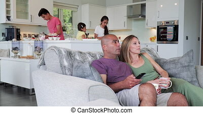 Lets see Whats on the Television - Side view of parents...