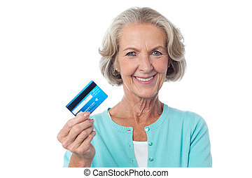 Let's shop with my credit card. - Senior woman displaying ...
