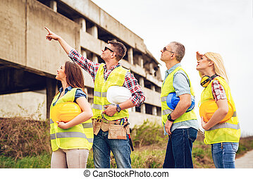 Let's Start Over There! - Construction architects pointing ...