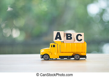 Letter a, b, c alphabet wooden cubes blocks put on toy pickup truck
