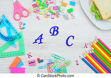 letter a b c on table