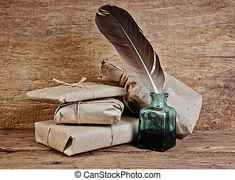 letter and a quill in the inkwell