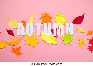 letter autumn cut from paper with paper autumn leaves