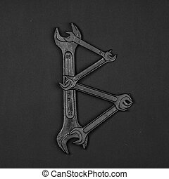 Letter B. Alphabet made of repair tools