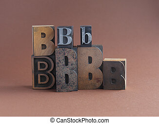 letter B in wood and metal type