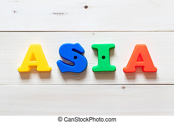 Letter block in word asia on white wood background