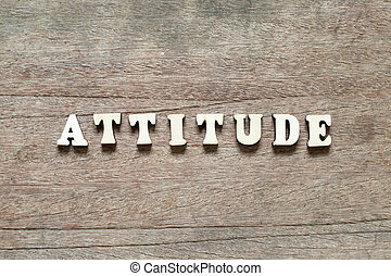 Letter block in word attitude on wood background
