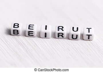 Letter block in word Beirut on white wood background. Lebanon concept.